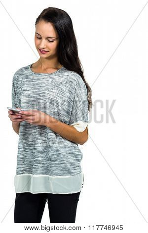 Attractive woman using smartphone standing on white screen