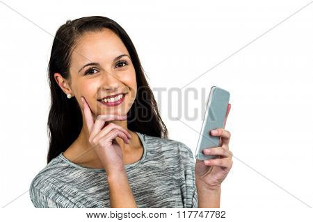 Smiling woman with hand on cheek using smartphone on white screen