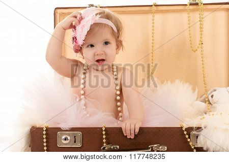 female baby in the suitcase