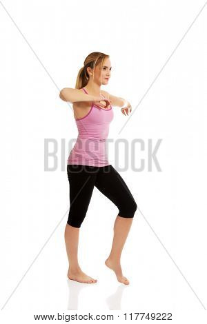 Young woman doing aerobic exercise.