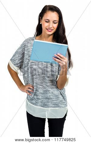 Young smiling woman using tablet on white screen