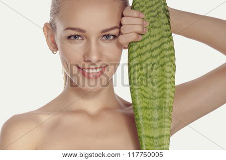 Girl Holds A Large And Long Green Leaf And Smiling.