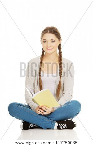 Teen woman sitting with her notebook.