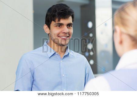 People indoors having talk