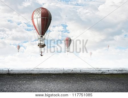 Aerostats flying over sky