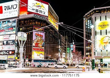 SAPPORO, JAPAN - December 25, 2015: Street view of Buildings around city night, one of the most popular tourist destinations in Sapporo, Hokkaido, Japan.
