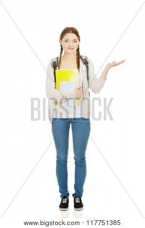 Teenage girl with open hand.