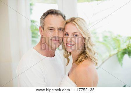 Cute couple hugging in the living room