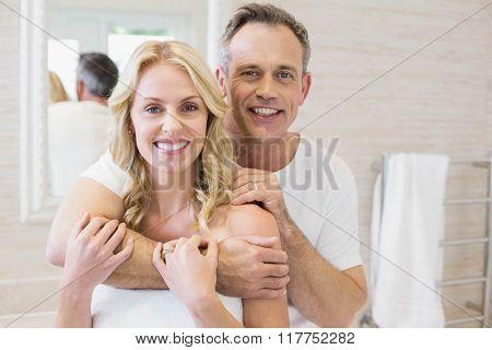 Cute couple hugging in the bathroom