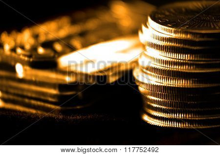 Pile of old coins and bullion with dark background