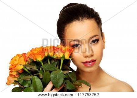 Beauty african woman with roses.