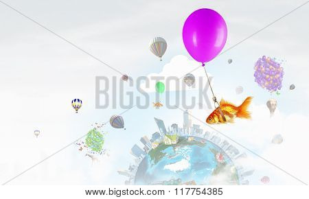 Goldfish fly on balloon