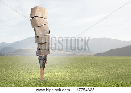 Woman carrying carton boxes