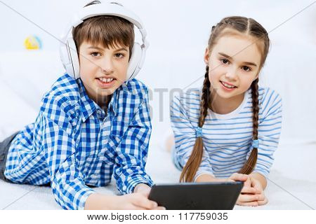 Cute kids gaming on tablet