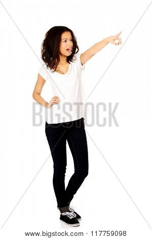 Young woman pointing up.