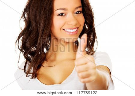 Happy woman with thumbs up.