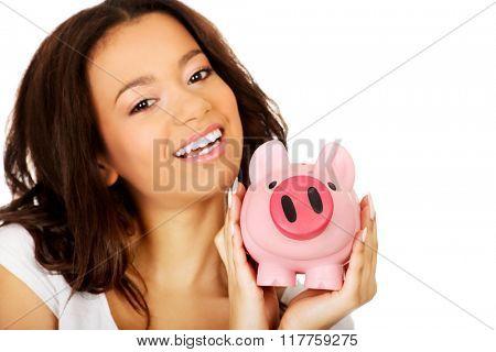 African woman with piggybank.