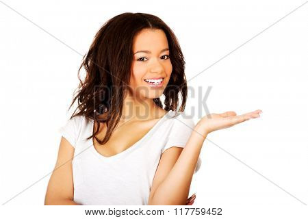 Woman holding something on palm.