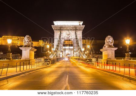 Nightshot on empty Szechenyi bridge, Danube river. Budapest city Hungary.