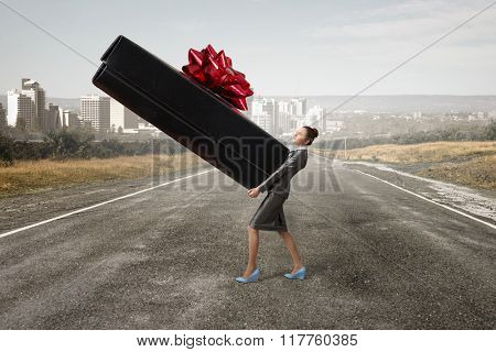 Businesswoman receiving or presenting gift
