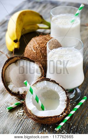 Coconut Tropical Smoothie Drink With Bananas On Wooden Background