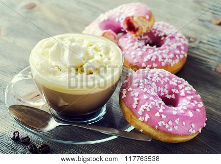 Cup Of Coffee With Pink Glazed Donuts On Wooden Background Vintage