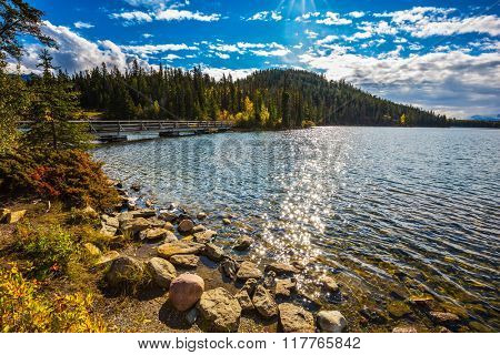 Cold sunny morning in the Rocky Mountains, Canada. Summer morning breeze lifts light ripple on the Pyramid Lake