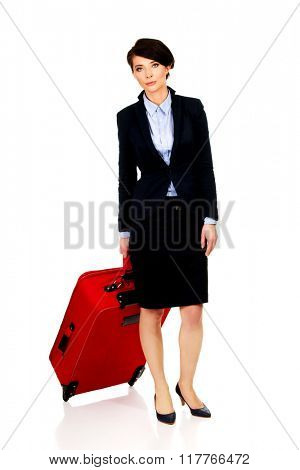 Happy businesswoman with suitcase.