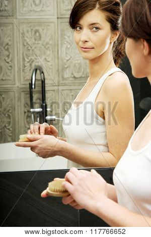 Woman cleaning her nails.