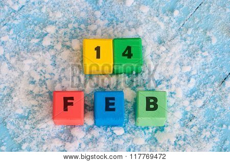 Valentine's day. Calendar date on color wooden cubes with marked Date of 14  Of February