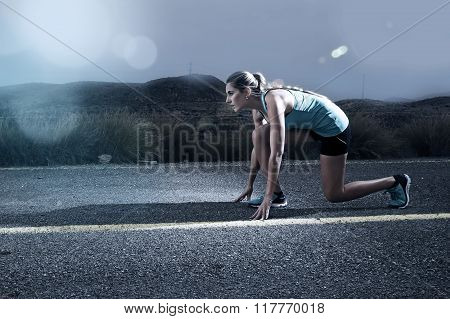Sport Woman Posing On Start Grid Style Ready For Running Workout On Asphalt Road In Dramatic Harsh L