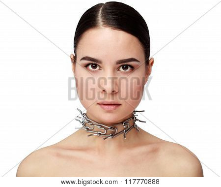 Close-up Of Attractive Brunette Girl In A Metal Collar With Spikes
