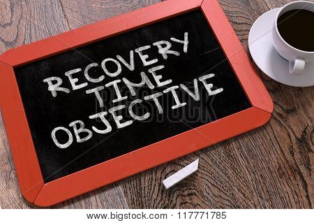 Recovery Time Objective Handwritten by white Chalk on a Blackboard.