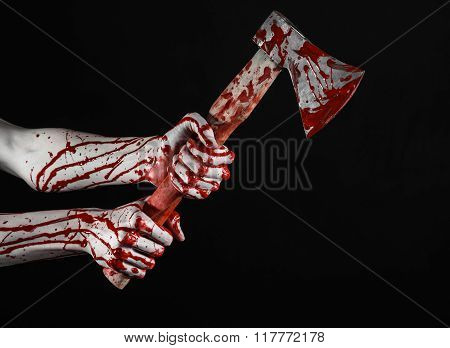 Bloody Halloween Theme: Bloody Hand Holding A Bloody Butcher's Ax Isolated On Black Background In St