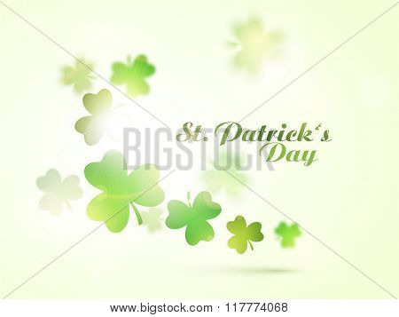 Glossy shamrock leaves decorated greeting card design for Happy St. Patrick's Day celebration.