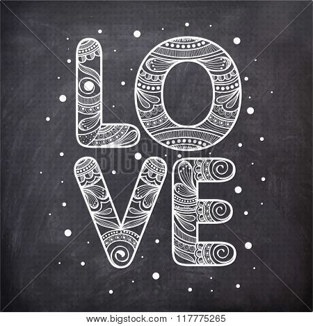 Floral design decorated stylish text Love on vintage chalkboard background for Happy Valentine's Day celebration.