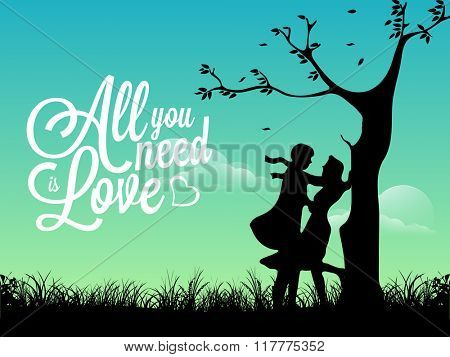 Cute young couple in love under tree on evening background for Happy Valentine's Day celebration.
