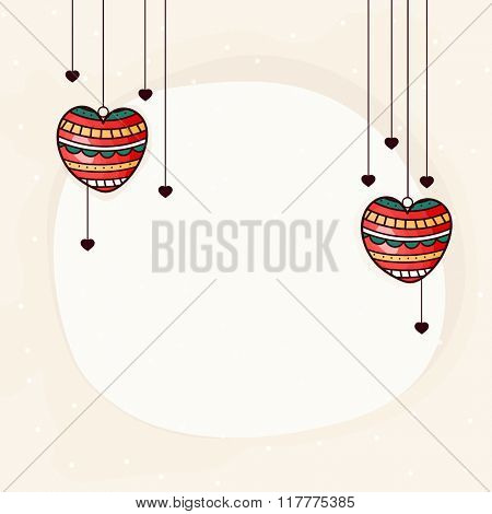 Colorful hanging hearts decorated greeting card for Happy Valentine's Day celebration.