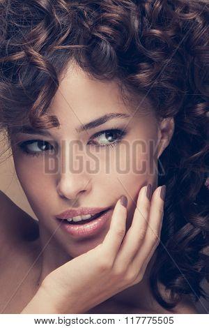 curly hair beauty woman portrait, studio shot, closeup