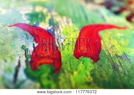 Abstract wooden table with colorful paint spot on the surface