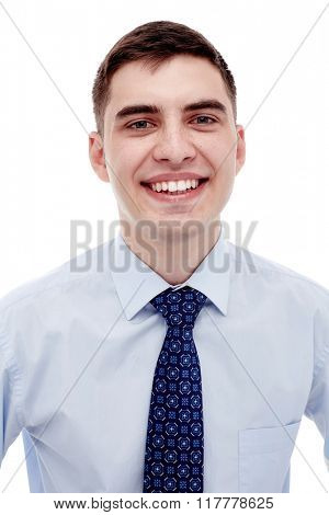 Front portrait of young smiling man wearing blue formal shirt with tie isolated on white background - business concept