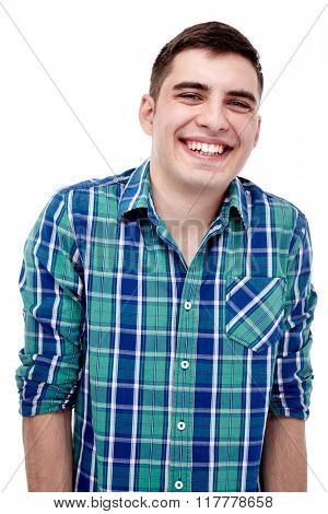 Front portrait of young laughing man wearing blue checkered shirt isolated on white background - laughter concept