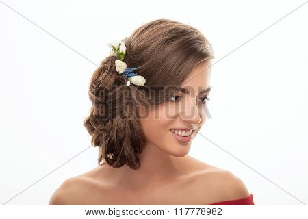 Closeup beauty portrait of smiling young adorable brunette woman with trendy makeup low bun hairstyl