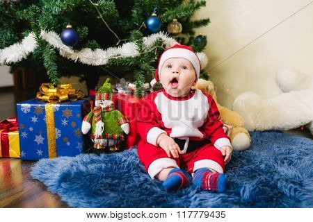 Baby dressed in Santa Claus
