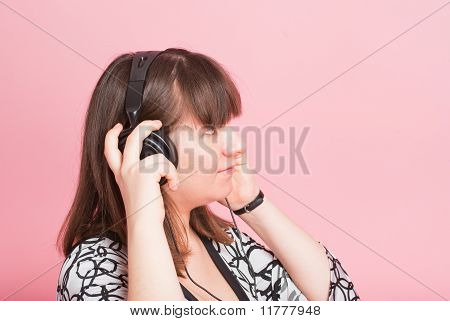 The Pregnant Girl Listens To Music In Ear-phones