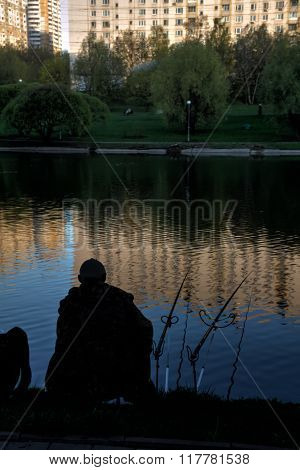 Fisherman. Pond. City.