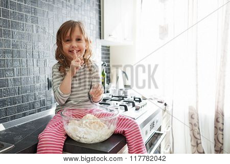 5 years old child cooking holiday pie in the kitchen, casual still life photo series, surprise for mom
