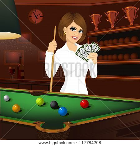 beautiful business woman holding cue stick and fan of money