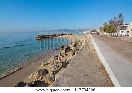 Molinar Boardwalk And Small Rock Pier