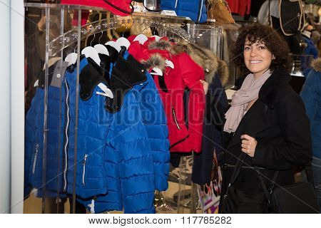 Happy  Girl In Black Trench Coat Shopping - Surprised Woman